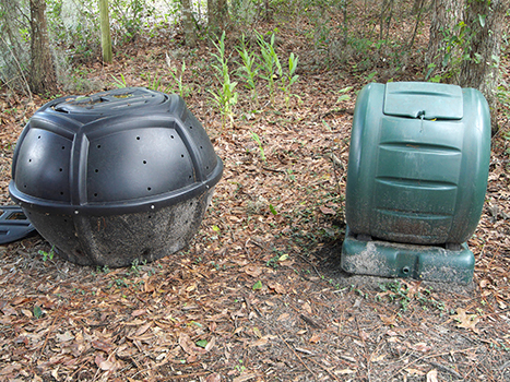 Two styles of compost bins: a rolling composter and a compost tumbler.